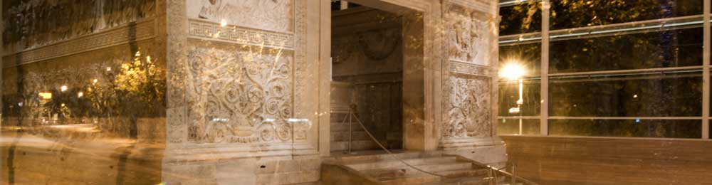 View of Ara pacis with night lights reflected from outside